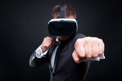 Violent male playing game thru vr glasses Stock Images