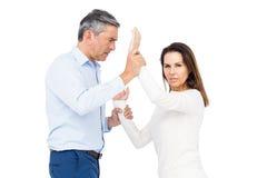 Violent man grabbing wifes wrists Stock Photos