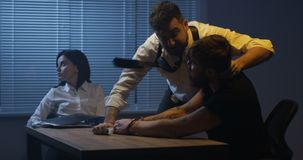 Violent policeman interrogating criminal about drugs