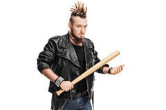 Violent punk rocker holding a baseball bat. Young violent punk rocker holding a baseball bat and looking at the camera isolated on white background Royalty Free Stock Image