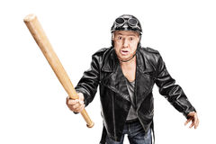 Violent senior biker swinging with a baseball bat Stock Image