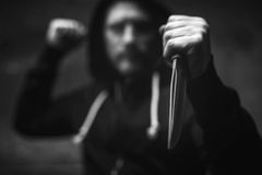 Violent senseless maniac stabbing his victim Stock Photography