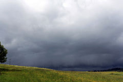 A violent storm is over a field Royalty Free Stock Photo