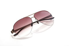 Violent sunglass on the white background Royalty Free Stock Image