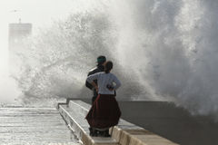 Violent waves breaking against pier Stock Photo