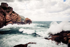 Violent Waves Splashing Against Corsica`s Coast. Just off the city of porto in the island`s north-west Royalty Free Stock Photos
