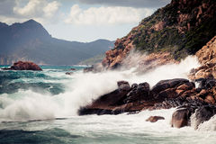 Violent Waves Splashing Against Corsica`s Coast. Just off the city of porto in the island`s north-west Royalty Free Stock Images