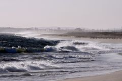 Violent beach. Violent and windy day at Faro beach on Portugal Stock Photos
