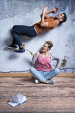 Violent woman controlling her partner. Violent women holding rope tied around man`s ankle, controlling partner Stock Photos