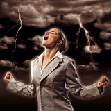Violent woman. Furious woman is straining arms and looking up, concept violent person Stock Photo