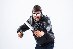 Violent young man holding weapons Stock Photo