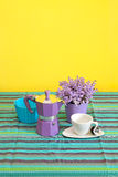 Violet. Coffee pot and cup in colourful retro interior Stock Photo