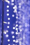 Violet abstract background. Blurry light bokeh in the night. Led lights with bokeh background. Flashing lights royalty free stock image
