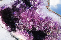 Violet. An amethyst crystal geode sitting in the snow Royalty Free Stock Photography