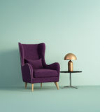 Violet armchair over pale green wall Royalty Free Stock Images