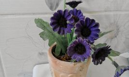 Violet artificial decor flower Stock Photography