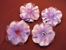 Violet artificial fabric flowers Royalty Free Stock Image
