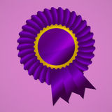 Violet award ribbon rosette on pink background Stock Photos