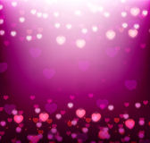Violet background with bright hearts Royalty Free Stock Images