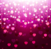 Violet background with bright hearts and sparkles Stock Images
