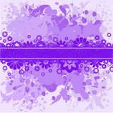 Violet background with lilac flowers. Abstract spattered violet background with lilac flowers Royalty Free Stock Photography