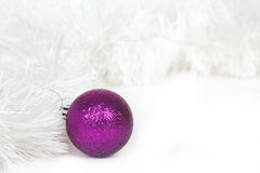 Violet ball and Christmas tinsel Royalty Free Stock Image