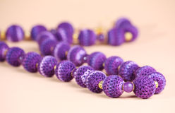 Violet beads Stock Images