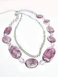 Violet beads with silvery chain Stock Photos