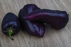 Violet bell peppers Royalty Free Stock Image