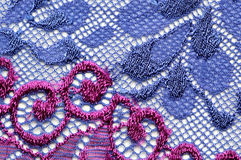 Violet and blue flowers lace material texture macro shot Royalty Free Stock Photo