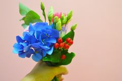 Small beautiful bouquet of flowers for the little girl stock photography
