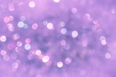 Violet blurred background with bokeh lights Royalty Free Stock Images