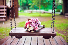 Violet bouquet bride on a swing Royalty Free Stock Photography