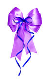 Violet bow with blue ribbon made from silk Royalty Free Stock Photo