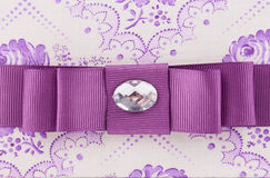 Violet bow with gem. Royalty Free Stock Photos