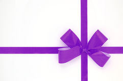 Violet bow isolated over white background Stock Photos