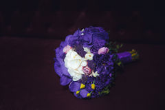 Violet bridal bouquet on black background royalty free stock image