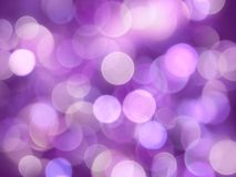 Violet bright blurred round lights glowing abstract background royalty free stock image