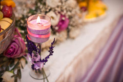 Violet candle. Royalty Free Stock Images