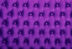 Violet capitone tufted fabric upholstery texture. Purple violet capitone textile background, retro Chesterfield style checkered soft tufted fabric furniture Royalty Free Stock Photography