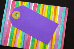 Violet card tag. Royalty Free Stock Image