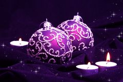 Violet Christmas Balls and Candles. On Velvet Royalty Free Stock Photo