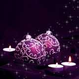 Violet Christmas Balls and Candles. On Velvet Stock Photography