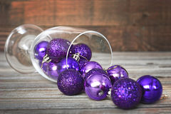 Violet Christmas balls in wineglass Royalty Free Stock Image