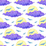 Violet clouds, yellow moon and blue bats silhouettes on white background vector Halloween seamless pattern Stock Photography