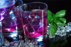 Violet coctail with ice cubes Stock Photography