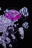 Violet coctail with ice cubes Royalty Free Stock Photo