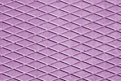 Violet color cement floor with rhombus pattern. Royalty Free Stock Image