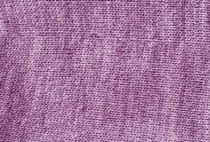 Violet color knetted cloth surface Royalty Free Stock Photo