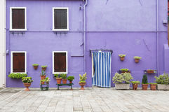 Violet colorful house of Burano Island, Venice, Italy Stock Photos